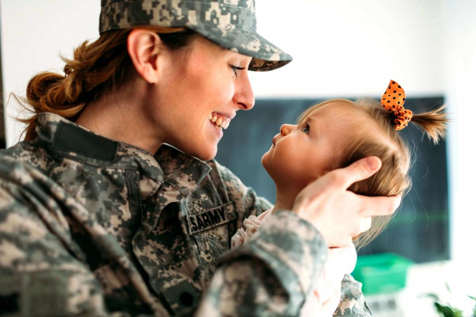 Military mother looking at her baby