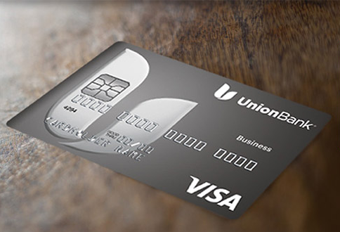 This is an image of a Business Visa Credit Card displayed on a wooden surface