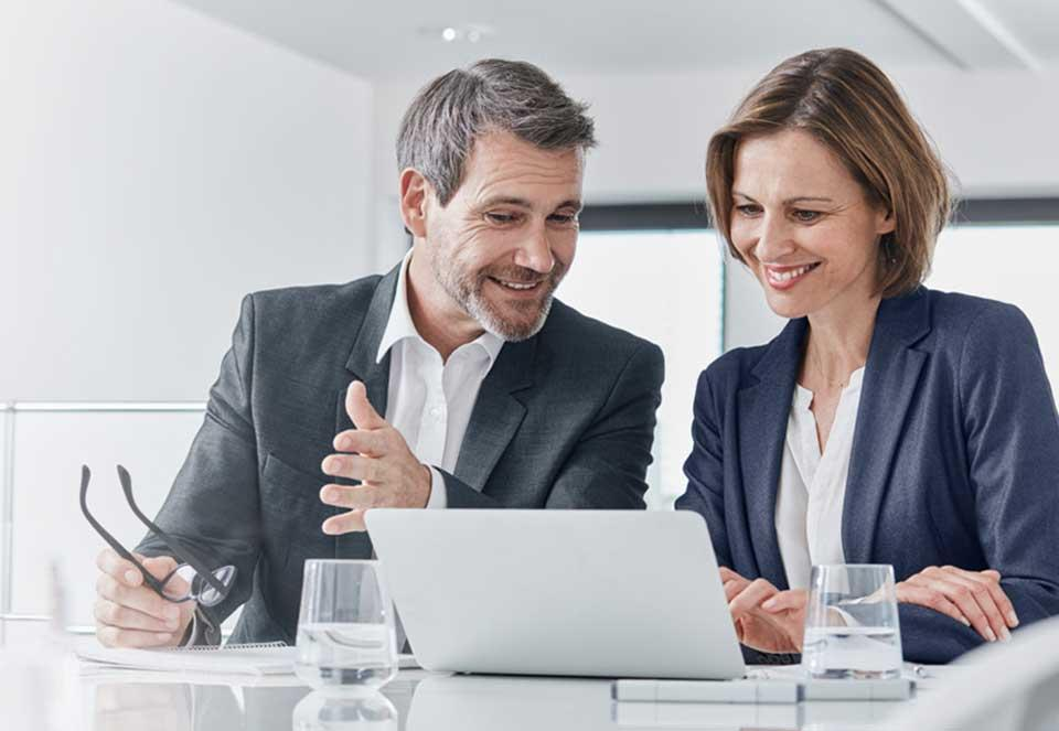 Two business owners reviewing plans