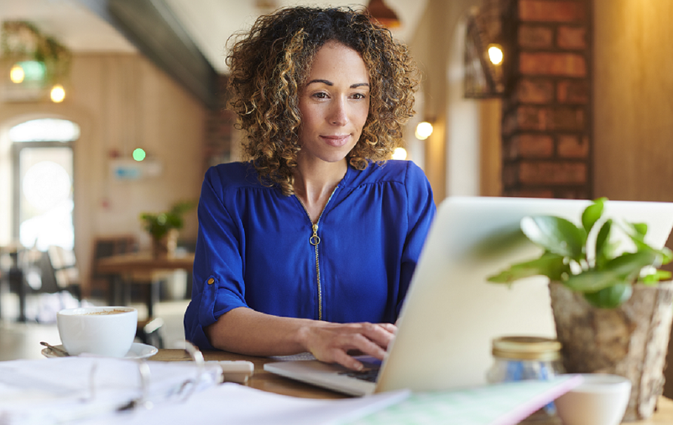 Female using online banking at her business