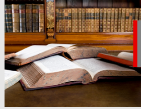 Image of two open books in a library