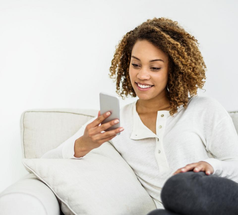 Woman on her phone using online banking