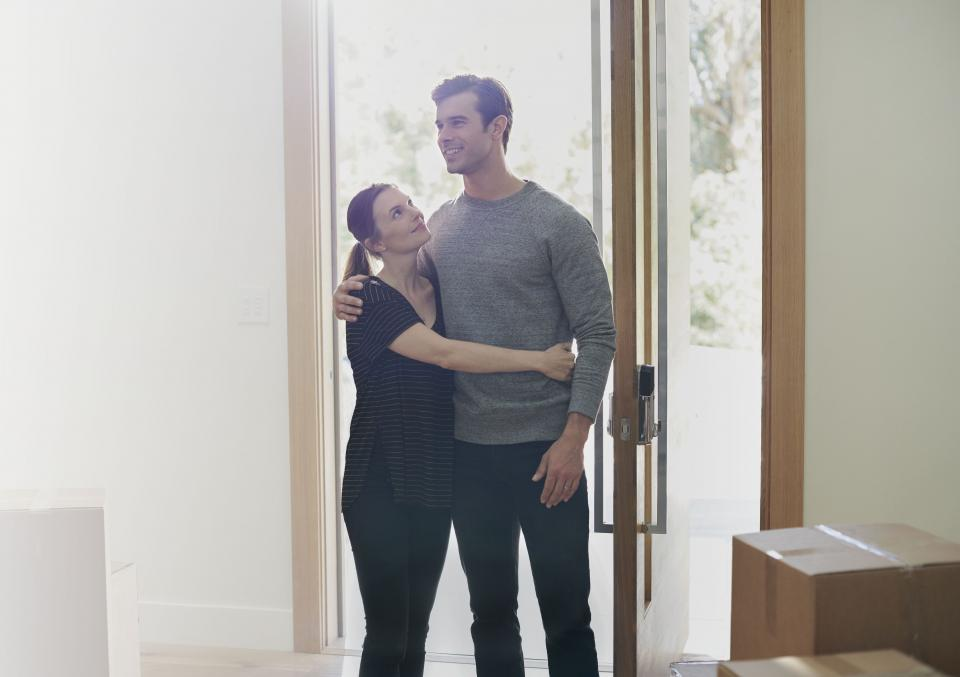 Couple in doorway of a newly purchased home