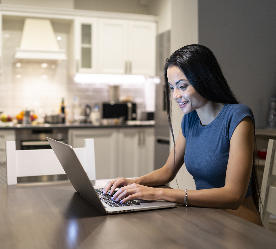 Woman using Online Banking on a Laptop