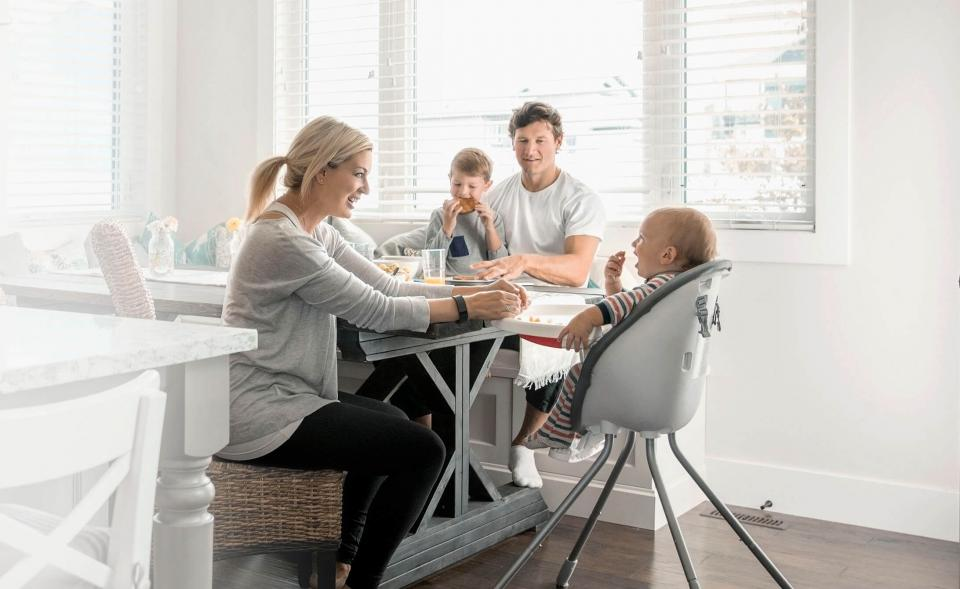 Parents with young children enjoying a meal at home