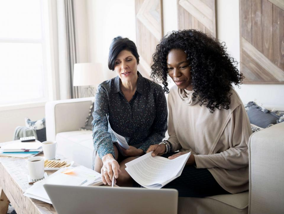 Female client working with her investment services financial advisor