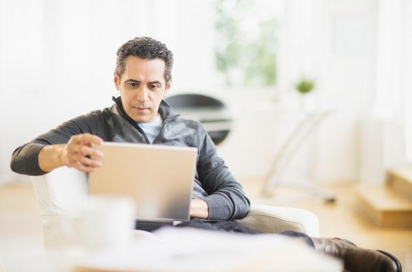 Gentleman reviewing accounts on laptop