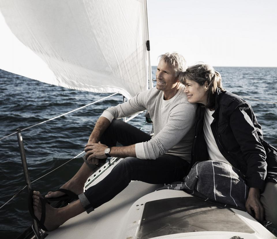 Wealthy couple boating at sea