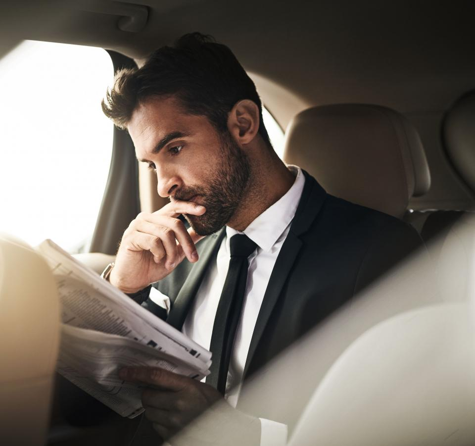 Business owner reading the newspaper
