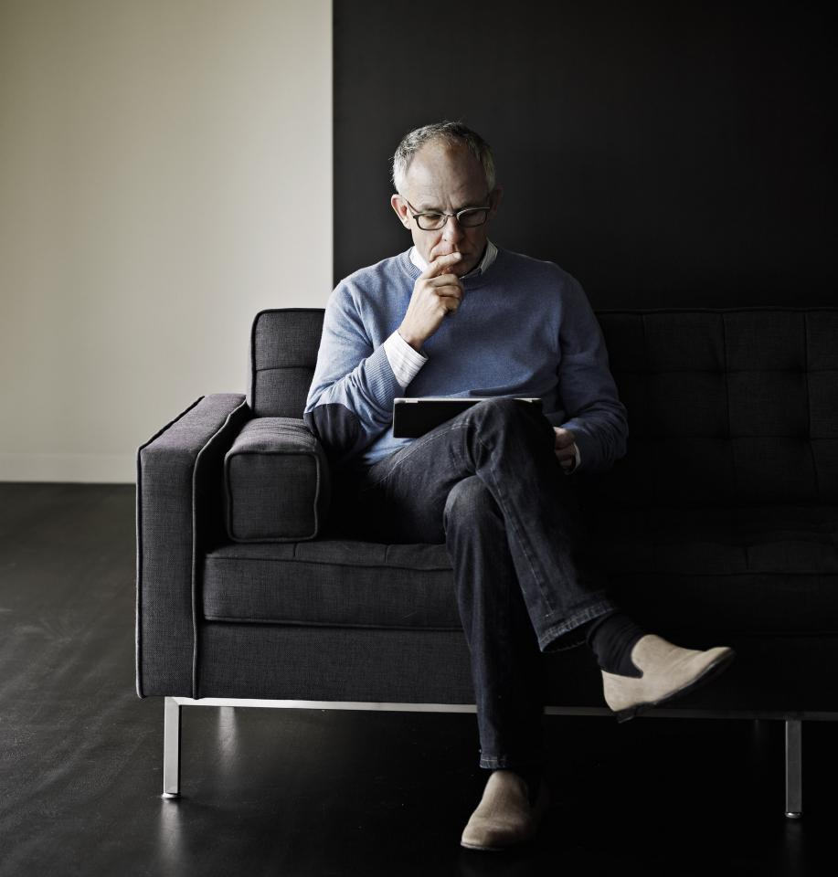 Wealthy investor doing research on a tablet