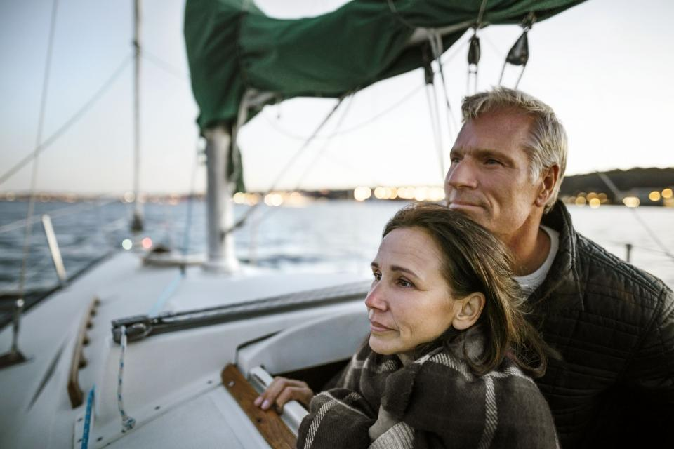 This is an image of a couple on a boat