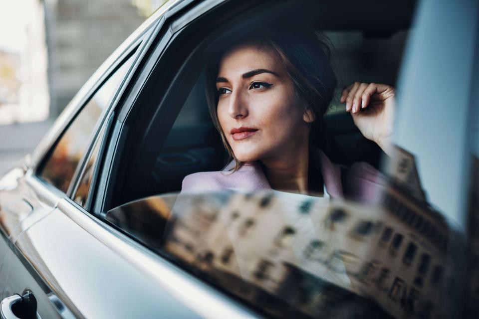business woman in a car