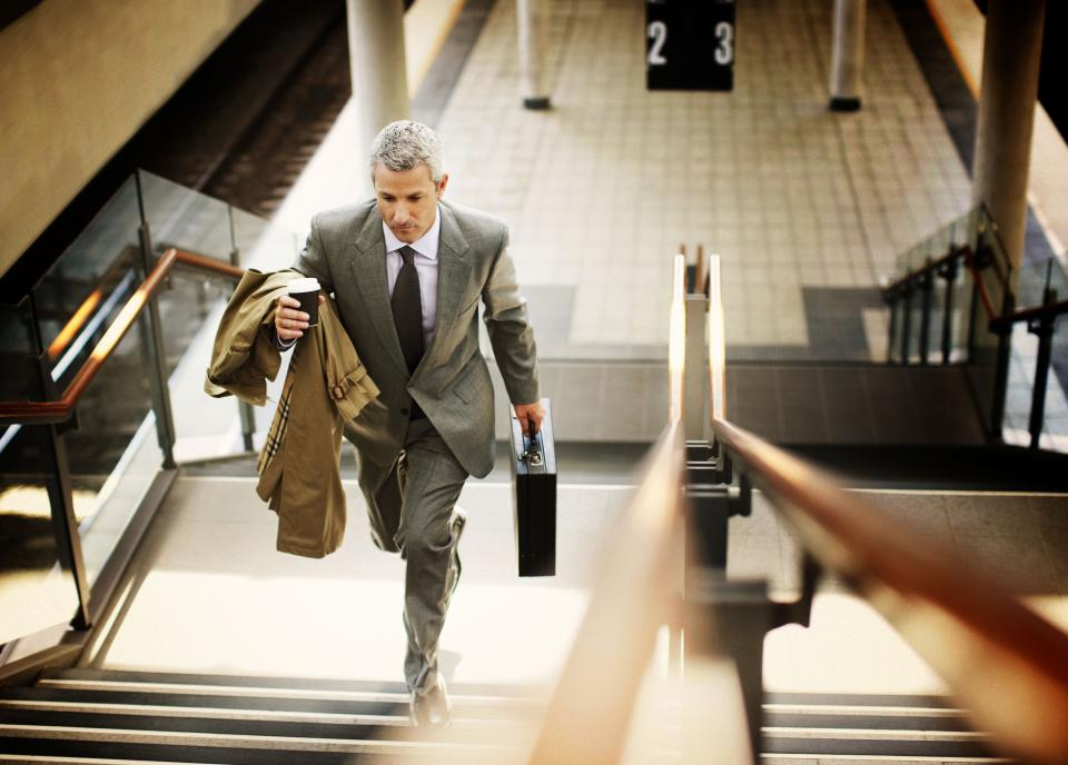 Business man climbing stairs