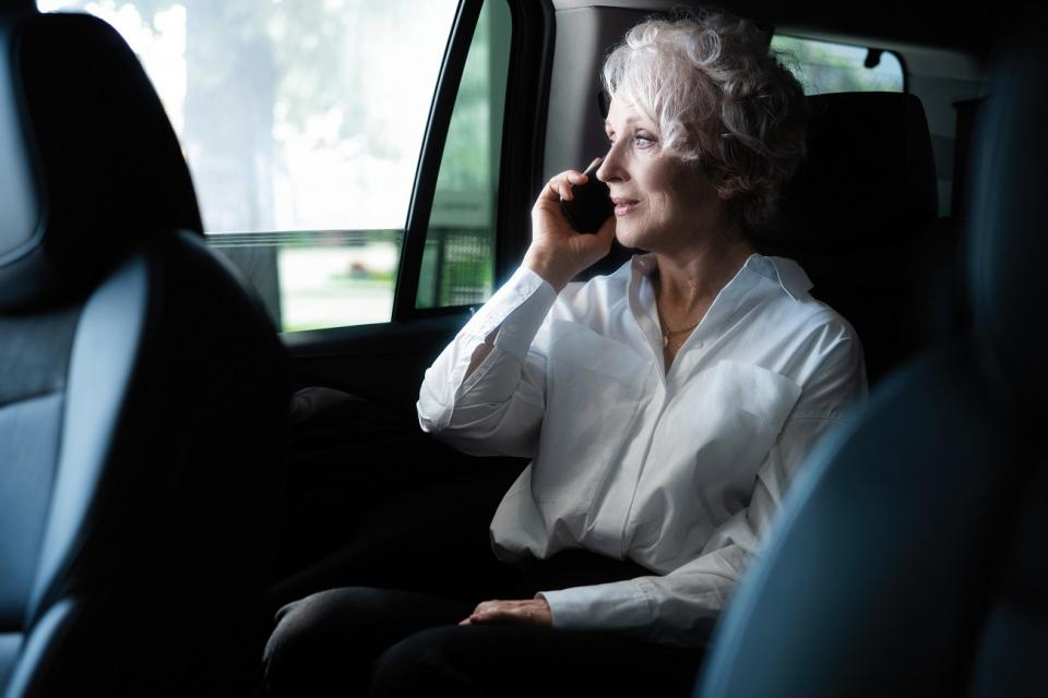 wealthy woman on phone