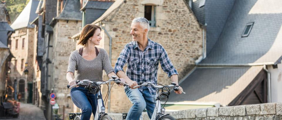 couple on bikes in Europe