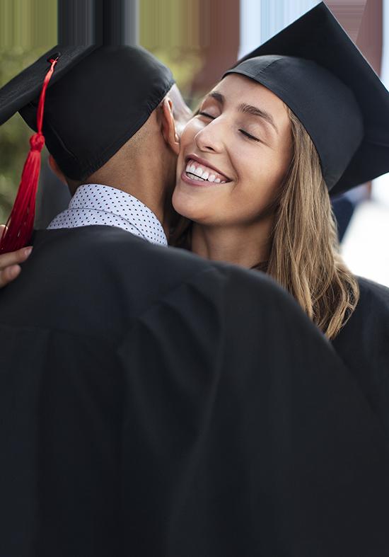 Two college graduates hugging